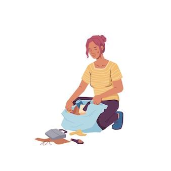 Femme avec sac ramassant les ordures ménagères isolées