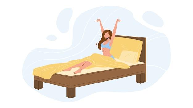 Femme se réveiller le matin dans un lit confortable