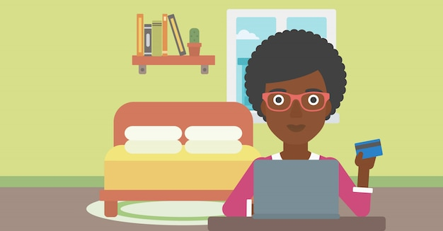 Femme shopping en ligne en utilisant son ordinateur portable.
