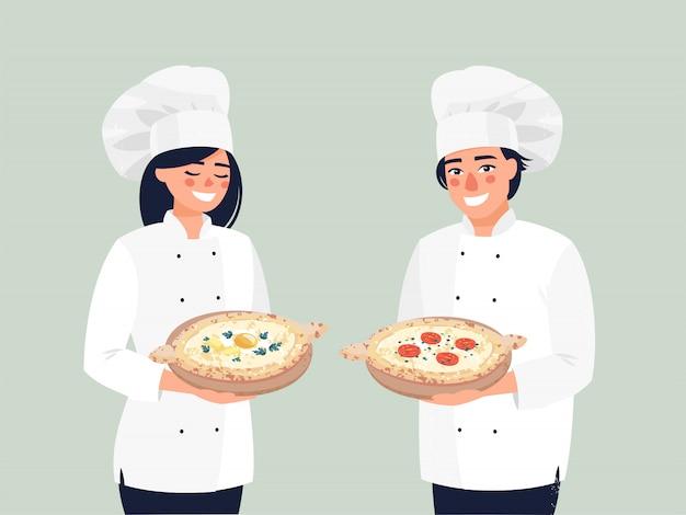 Femme souriante cuisinier shef et homme cuisinier shef se tient avec khachapuri.