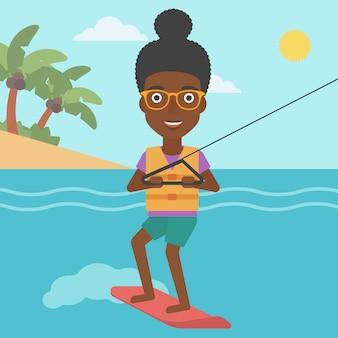 Femme de sport professionnel de wakeboard.