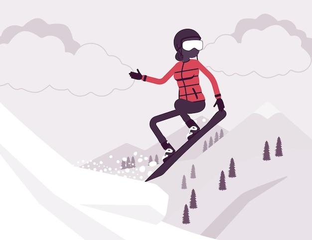 Femme sportive active faisant du snowboard, sautant
