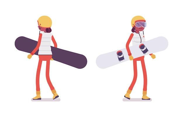 Femme sportive transportant du matériel de snowboard