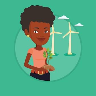 Femme tenant illustration vectorielle de petite plante.