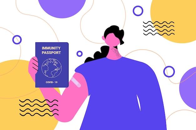 Femme tenant un passeport d'immunité mondiale sans risque de réinfection covid-19 certificat pcr concept d'immunité contre les coronavirus