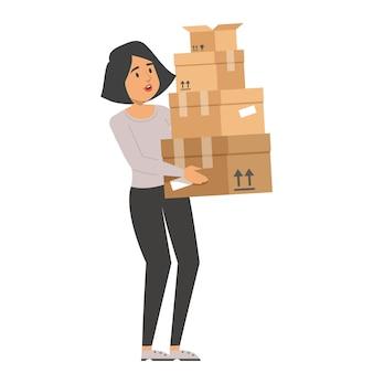 Femme tenant une pile de boîtes.