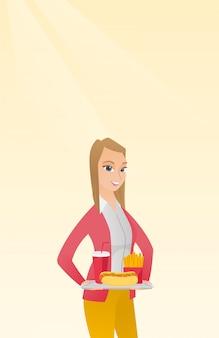 Femme tenant un plateau de restauration rapide.