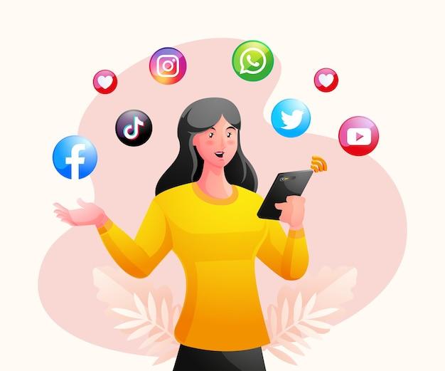 Femme tenant un smartphone et utilisant les médias sociaux