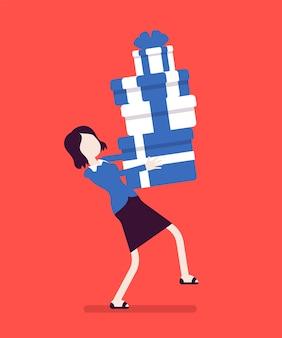 Femme tenant un tas de coffrets cadeaux