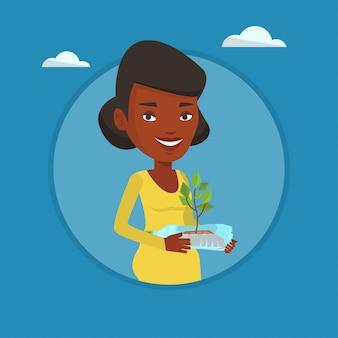 Femme, tenue, plante, croissant, plastique, bouteille