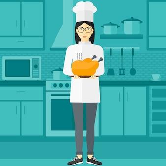 Femme, tenue, poulet rôti