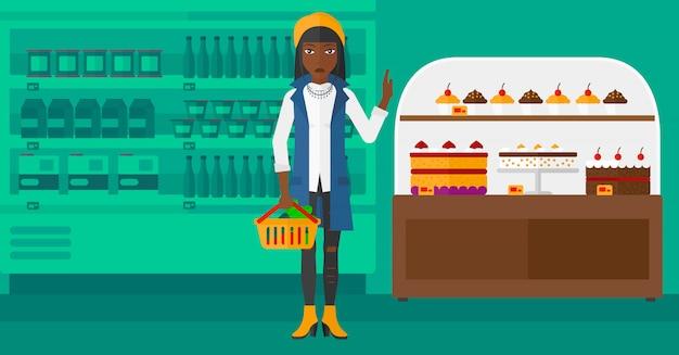 Femme, tenue, supermarché, panier