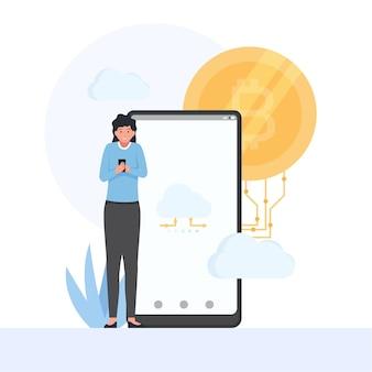 Une femme tient un téléphone et un bitcoin derrière la métaphore du cloud mining