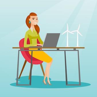 Femme travaillant avec le modèle d'éoliennes.