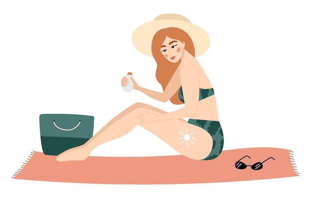 Femme utilisant une crème de protection solaire