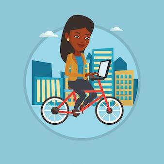 Femme à vélo dans la ville.