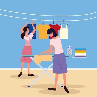 Femmes accrochant des vêtements propres