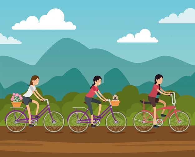 Femmes amies à bicyclette