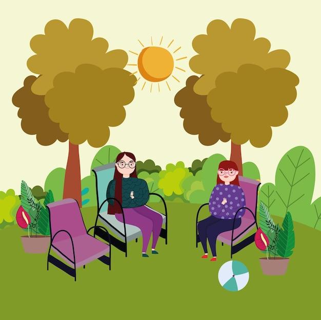 Femmes assises sur des chaises