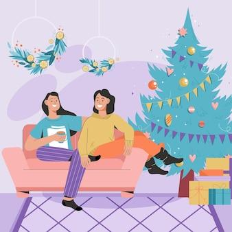 Les femmes heureuses célèbrent noël ensemble à la maison