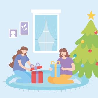 Femmes heureuses sur le tapis célébration de noël ouverture des coffrets cadeaux vector illustration