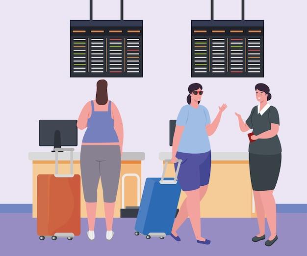 Femmes et hôtesse de l'air dans le terminal de l'aéroport