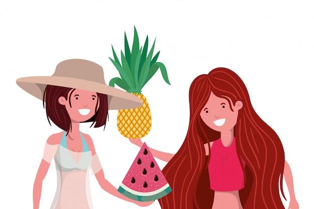 Femmes avec maillot de bain et fruits tropicaux à la main