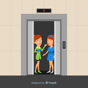 Femmes parlant dans l'ascenseur