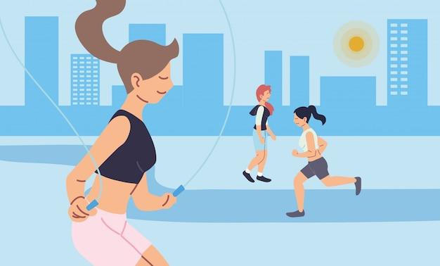 Femmes qui courent et sautent à la conception de la ville, rester en bonne santé, sport et activité de plein air