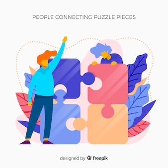 Femmes reliant des pièces de puzzle fond