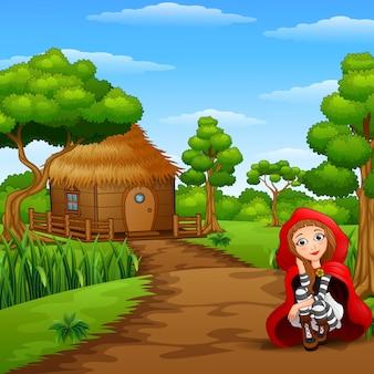 Femmes rouges à capuchon à la campagne