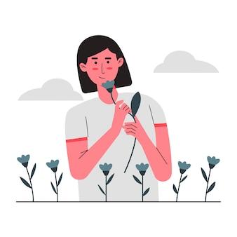 Les femmes sentent la fleur au jardin