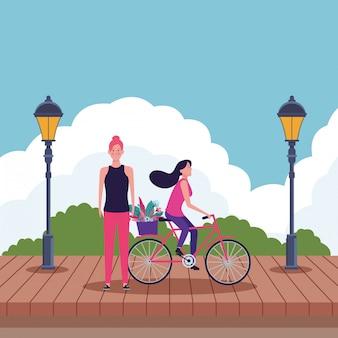 Femmes à vélo avec fleur