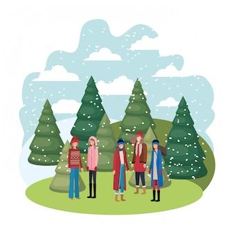 Femmes avec des vêtements d'hiver et le personnage d'avatar de pins d'hiver