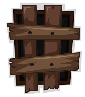 Fenêtre cassée avec des planches en bois clouées