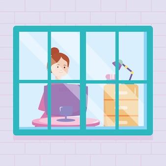 Fenêtre de la maison montrant une femme avec un ordinateur