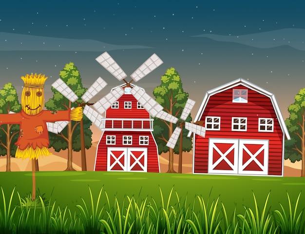 Ferme en scène nature avec grange et moulin à vent et épouvantail