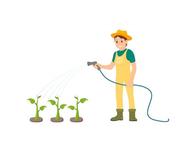 Fermier arrosant des plantes