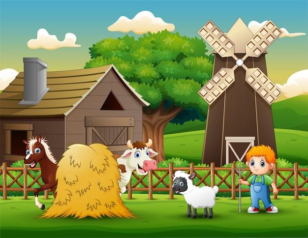 Les fermiers gardant des animaux à la ferme