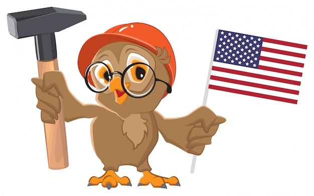 Fête du travail aux états-unis. chouette tenant le marteau et le drapeau américain