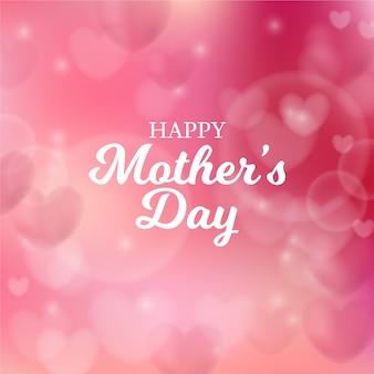 Fête des mères floue avec coeurs et salutation