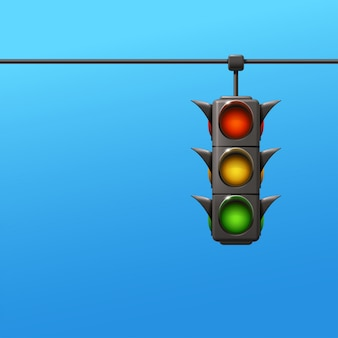 Feu de circulation sur fond bleu