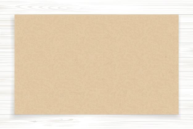 Feuille de papier brun sur bois blanc.