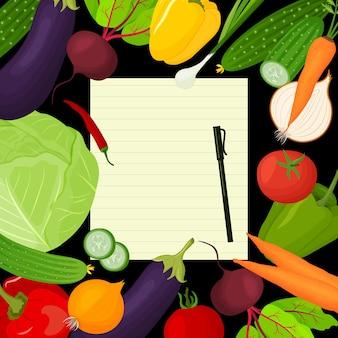 Une feuille pour rédiger des recettes entourées de légumes frais