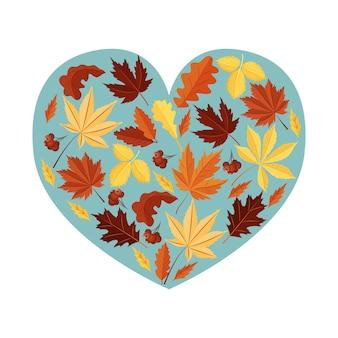 Feuilles d'automne sur fond bleu en forme de coeur. un élément de conception. vecteur.