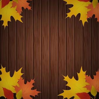 Feuilles d'automne sur fond de bois