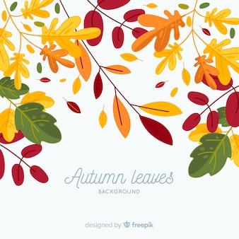 Feuilles d'automne fond dans un style plat