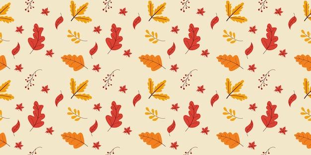 Feuilles d'automne modèle sans couture dans les couleurs orange, beige, marron et jaune.