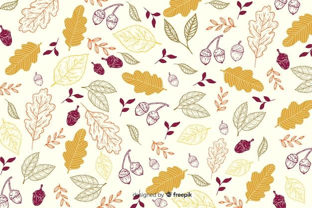 Feuilles dessinées à la main fond automne