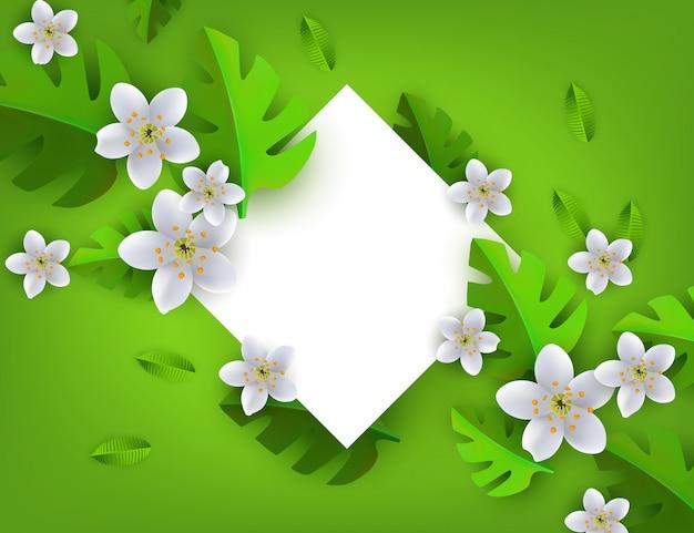 Feuilles tropicales vertes avec cadre de fleurs blanches, fond avec losange blanc.